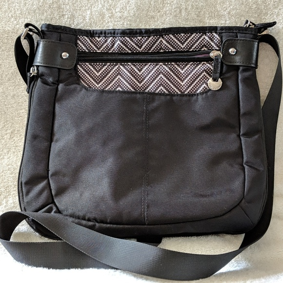 Travelon Bags   Sidetab Crossbody Bag Retired   Poshmark 5dd1295cb2
